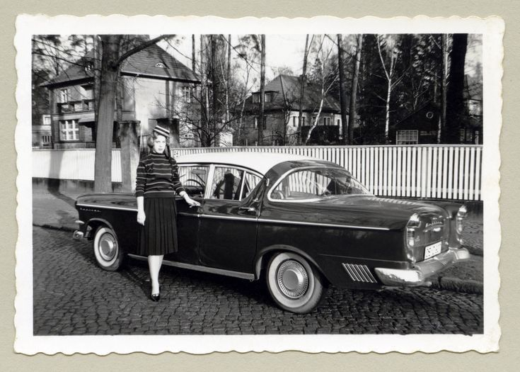 https://flic.kr/p/prK6Je | Opel Kapitän P 2,5 | A tall blonde lady wearing a straw boater hat posing with an Opel in a residential street in wintertime. Note the American influence in the design of the big Opel, popularly known as Schlüsselloch Kapitän in Germany, because of the rear lights' resemblance to a key hole. It's hard to tell from this angle, but the car is most probably registered in the West German town of Olpe (OE = Kreis Olpe).  Country of origin: Germany