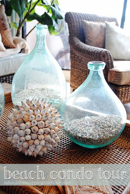 Tiny shells in glass vase.  Get from floundering hole.  Beach Condo Tour with lots of great decorating ideas.