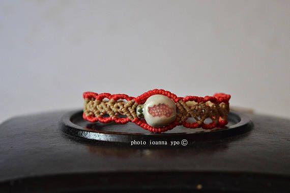 Macrame bracelet with ceramic pomegranate handwoven with #etsy #etsyseller #etsyshop #etsyfinds #etsygifts #etsyart #etsyartist #etsyaccessories #etsybracelet #etsystar #etsysale #etsydoesit #etsyfashion #ceramiccharm #pomegranate #macrame  #macramebracelet  #macramejewelry