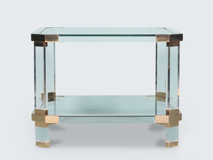 Glamourous 1970's modernist French side table constructed from a Lucite frame, brass joinery and glass shelving and table top. Absolutely stunning with a pair available. Each sold separately. Glass and Lucite is crystal clear even though it looks dark in pics!