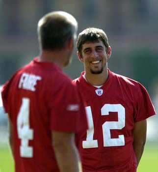 Aaron Rodgers is smiling because he knows he is about to crush a legend