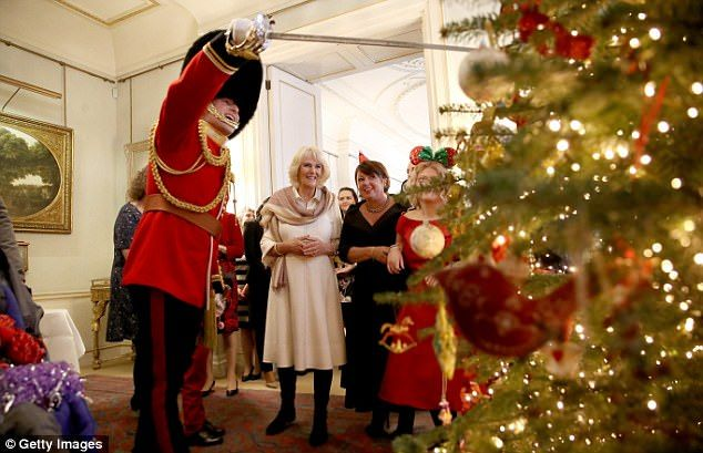The royal guard could be seen raising a smile among guests as he introduced the Christmas ...