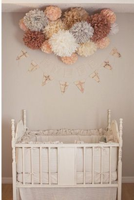 I know this is a nursery, but I love the colors of the paper poms and how they're organized in a cluster. Would look super cute at a party or shower.