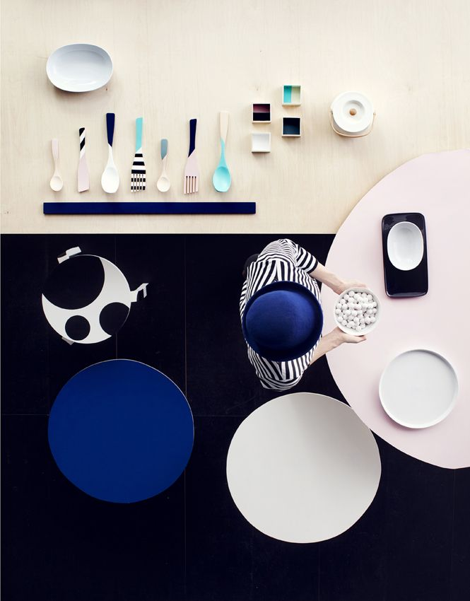 Make art from your old and new wooden utensils to brighten up your kitchen. The coloured areas were lined using masking tape and painted with acrylic paint available in crafting shops. Notice, that after painting tableware, you can't use it in your kitchen anymore, except as decoration.