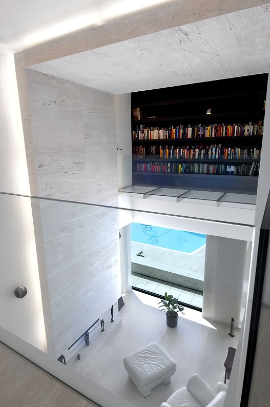 Stunning space with beautiful travertine stone. The House in Las Rozas by A-Cero.