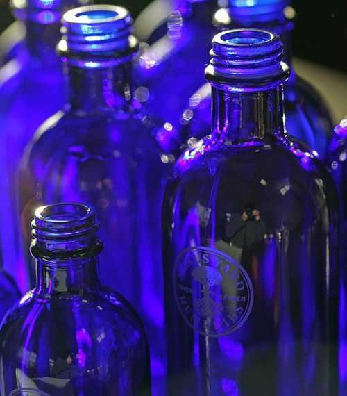 Neals Yard Remedies bottles: perfect dark blue pigment to naturally protect contents - also links to aspire2mind logo and is a colour in my colour chart