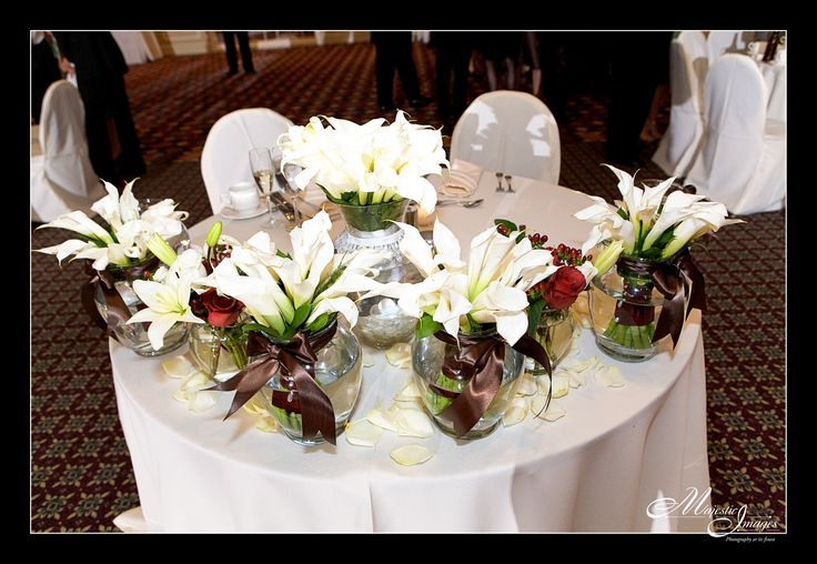 Stunning bouquets repurposed as decoration on Rachel and Hal's sweetheart table at Chase Center on the Riverfront.