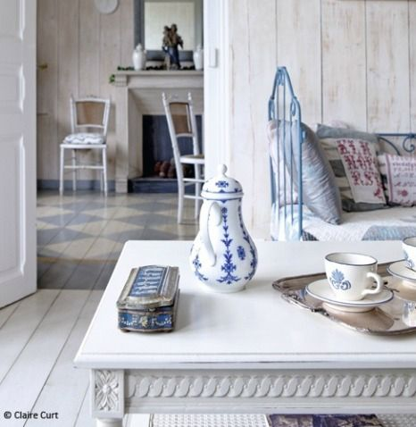 Scandinavian home with blue and white accessories, lime washed walls & a painted checkerboard floor - Claire Curt