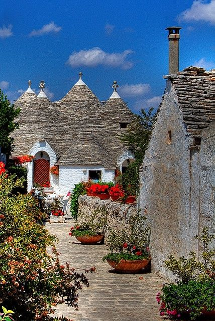 Trulli houses, Alberobello, Italy ~ traditional Apulian dry stone hut with a conical roof.