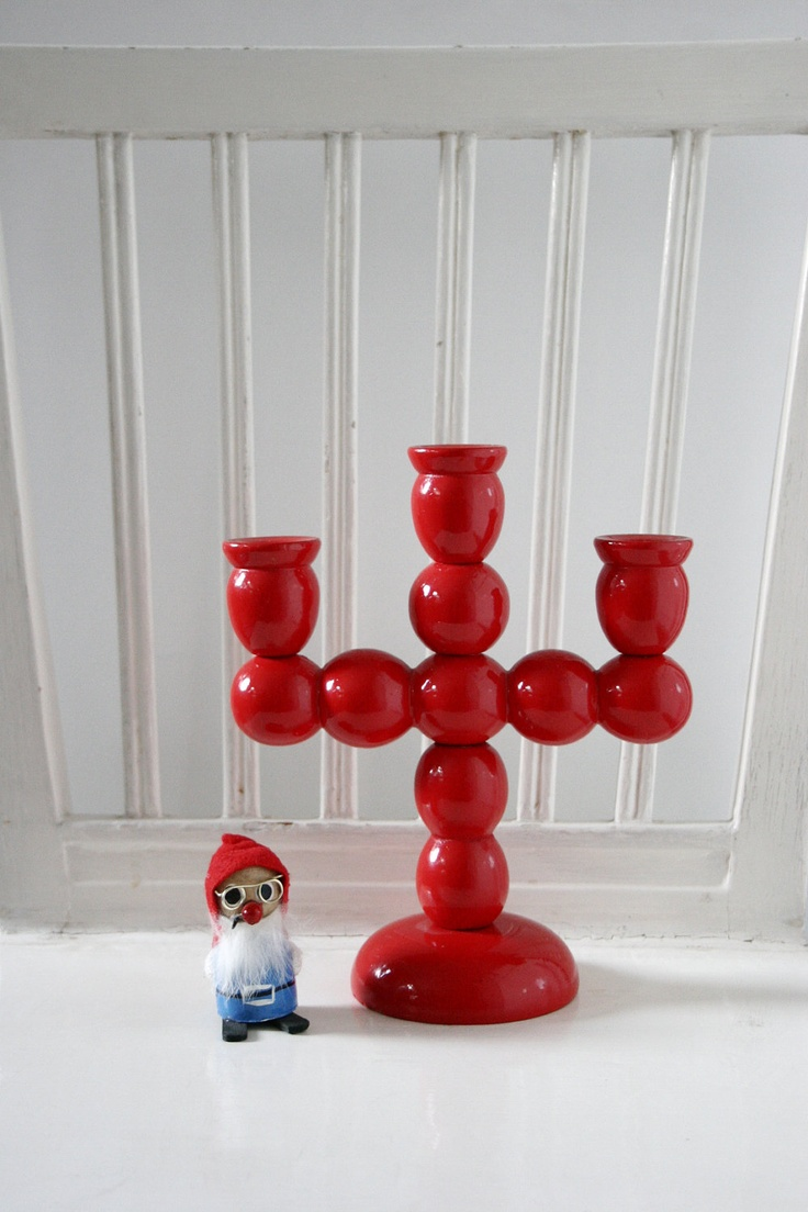 Swedish traditional red wooden candle holder