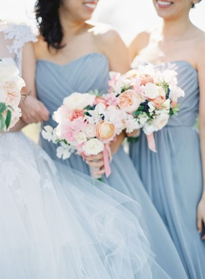 Blue dresses and pretty blooms: http://www.stylemepretty.com/2014/09/16/romantic-hillside-wedding-in-san-clemente/ | Photography: Kurt Boomer - http://kurtboomer.com/