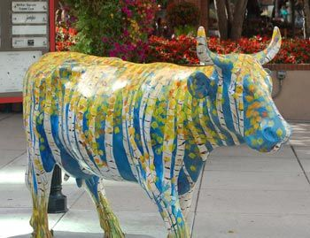 Denver Colorado Street Art.  There are these colorfully painted cows on many of the streets and each is unique