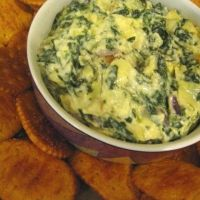 I am the official artichoke and spinach dip maker for any and every family get together.  I have used this recipe from the Better Homes and Gardens pink cookbook.  It really is amazing and so easy you'll make it all the time!  We use the Tostitos scoop chips for an every day use and during warmer days and then on holidays and during the colder months, I use warm fresh french baguettes.  Such a filler!