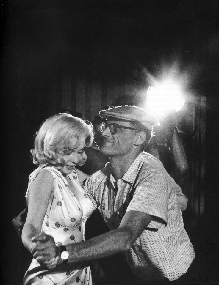 Marilyn Monroe and Arthur Miller. She looks scared that he'll step on her feet.