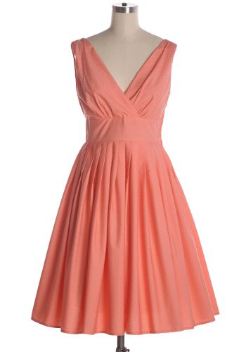 Lovely peach flared dress with tiny white pin dots, pleated skirt, and a v-neckline. Side zipper. 100% cotton Not stretchy Lined Fits large Styling Tip: Easy to layer with a cream cardigan for extra warm, or pair with heels for a classy day look! Indie, Retro, Party, Vintage, Plus Size, Convertible, Cocktail Dresses in Canada Summer Punch Dress -
