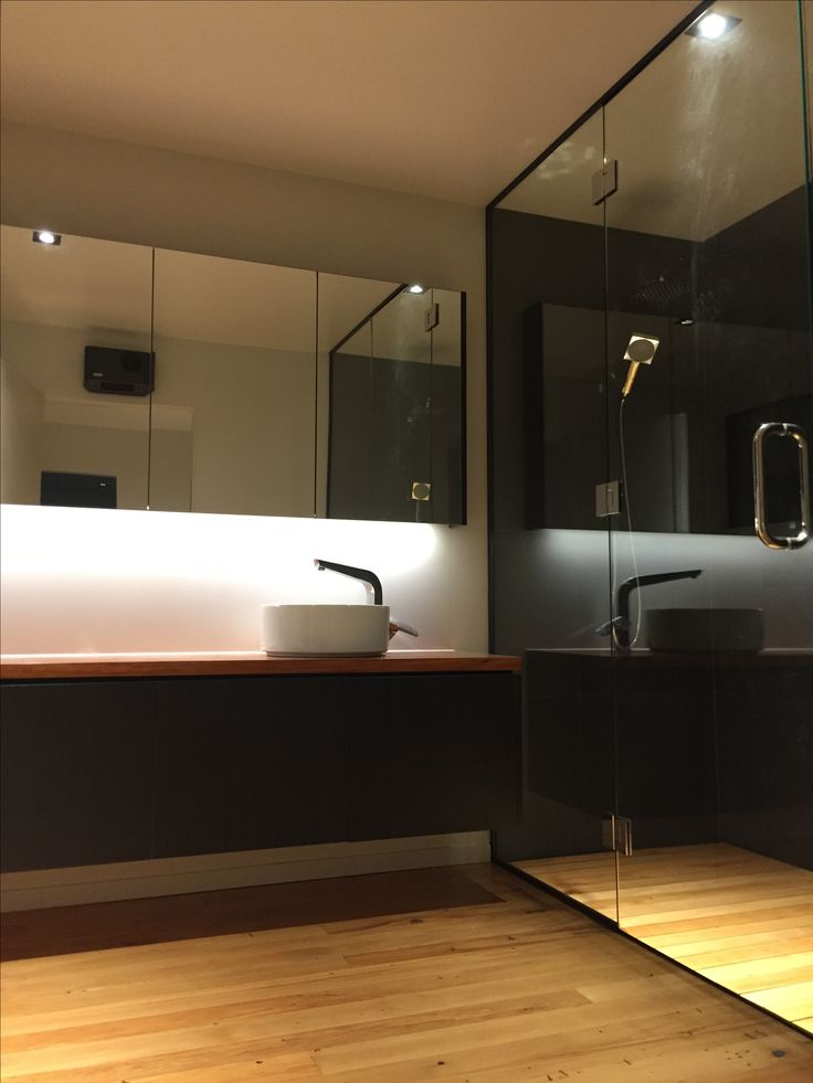 Waverley bathroom. Recycled timber floor and custom recycled rimu top handmade by Copland Building