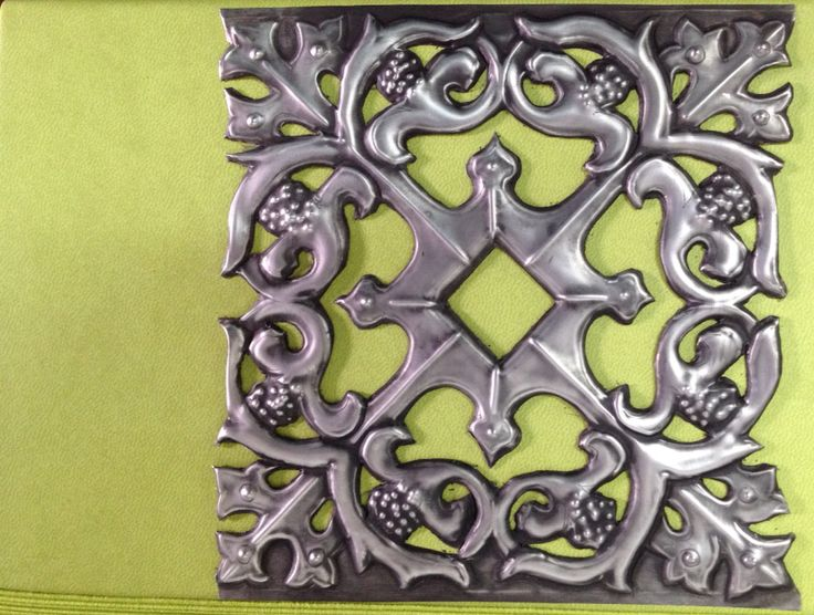 Filigree cutout pewter work done by Mary Ann Lingenfelder. mimmic Gallery and Studio