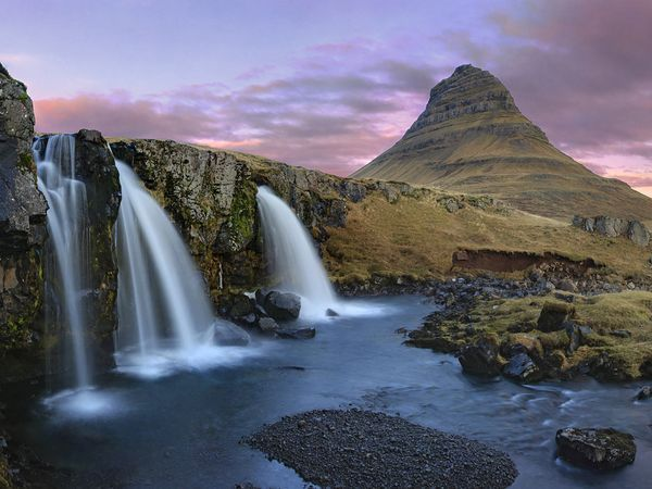 Best of the World 2012 - Iceland  Photograph by Johnathan A. Esper, Getty Images    Harmonic Convergence    Dusk falls on a primeval landscape on the Snæfellsnes Peninsula. A final relic from the world's last ice age, this North Atlantic island nation is a world of knife-cut valleys, gargantuan fjords, monumental cliffs, black-sand beaches, thundering waterfalls, and silent white glaciers. Recent volcanic eruptions remind us that Iceland is still a country in the making, with changed…