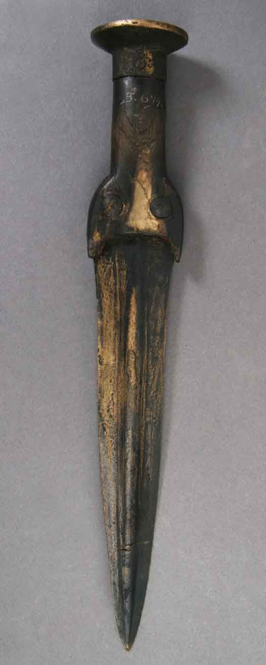 Grave goods from Iron Age Denmark - Iron Age Dagger. The woman also had two bronze bracelets, some spiral finger rings, a neck ring, brooches and a dagger with her in the grave.