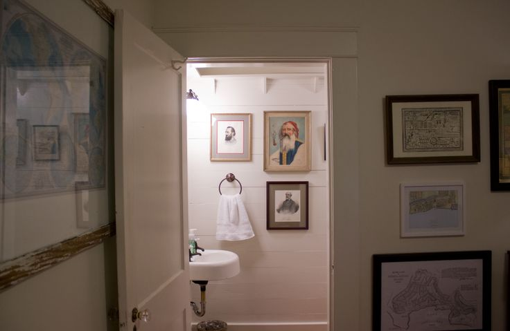 The last 2 big big Ben banners are up! They just photograph so well. And finally… I finished painting the trim in the new half bathroom, hung some art and took some photos to share with y'all. This used to be a big closet under the stairs in our office/den, but it was so long and narrow it wasn't very useable if you put anything at the back that you wanted to get out again someday. Ben used super inexpensive tongue-in-groove pine planks to cover the old plaster walls and ceiling and built a…