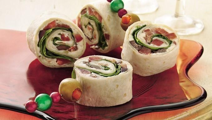 Bite-size pinwheels are bursting with Mediterranean flavor. Making them in advance reduces last-minute prep.
