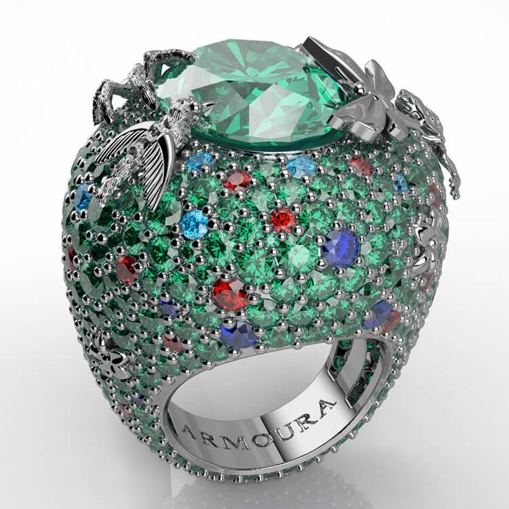 Rain Forest cocktail ring with emeralds, aquamarines, sapphires and rubies.
