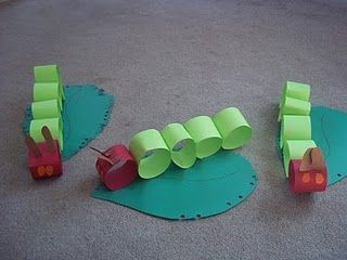 {Eric Carle Activities}  They used paper strips to create the links of the caterpillars body and decorated a giant leaf for it to sit on. I thought it was cute that they punched holes in the leaf to show the caterpillars little nibbles.