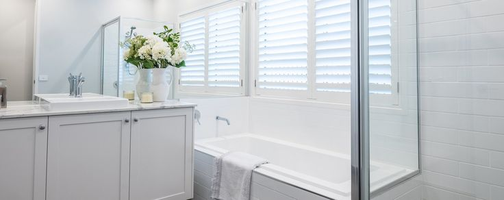 An all white bathroom in classic, cool white creates a timeless look - St. Tropez Home Design - On display at New Town TAS  #whiteinteriors #wilsonhomes
