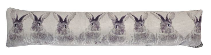 Wild grey bunnies draught excluder cushion with 8 adorable grey rabbits printed across the washed background.  Fun, practical accessory for your home to help keep the cold out, heat in and reduce your heating bills.  Size: 90cm (l) x 20cm (w) approx  Made from a quality and durable printed fleece material.  Backing is 100% polyester with a soft fleecy velour feel.