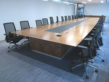 An exquisite bespoke office boardroom table to seat 30 people. American black walnut veneer top with painted glass centre insert. Immaculate condition.