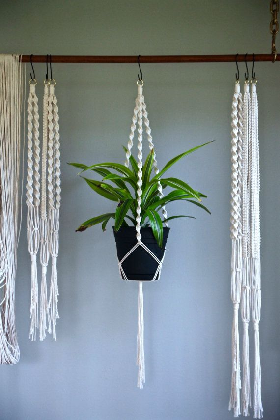 This classic macrame plant hanger is handmade with 3mm natural white cotton rope, has fully spiral knotted strands, and is hung by a small brass ring. It will fit a variety of pot shapes and sizes. Choose between a three or four strand style. Makes a lovely gift!  Measures approx. 40 total length. Hanging length will vary depending on the size and shape of pot used. Shown here with 8 diameter pots. Four strand version is shown in last two photos.  You can choose to have the fringe trimmed…