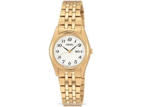 Ladies Date Watch   White dial w/black numerals  gold tone