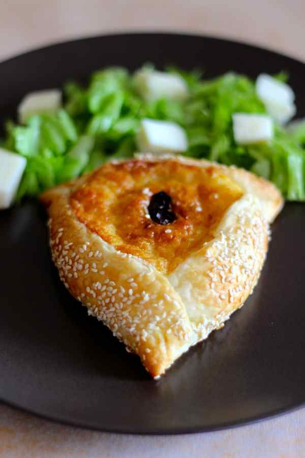 Flaounes are small traditional savory buns, stuffed with halloumi, prepared the week before Easter in Cyprus.