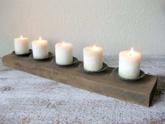 Approximate Measurements: 29.25 (w) x 3 (h) x 5.75 (d)  Add a little glow to your home with this dramatic rustic candle holder. Made from a nice, THICK piece of reclaimed barn wood from Phlox, Wisconsin from the now retired farm that has been in my family for 4 generations and 5 salvaged brown metal candle cups. Natural imperfections makes it perfect for display on your mantle, bar, or as a centerpiece on your dining room or kitchen table. Fits 3 to 3.5 pillar candles nicely as shown…