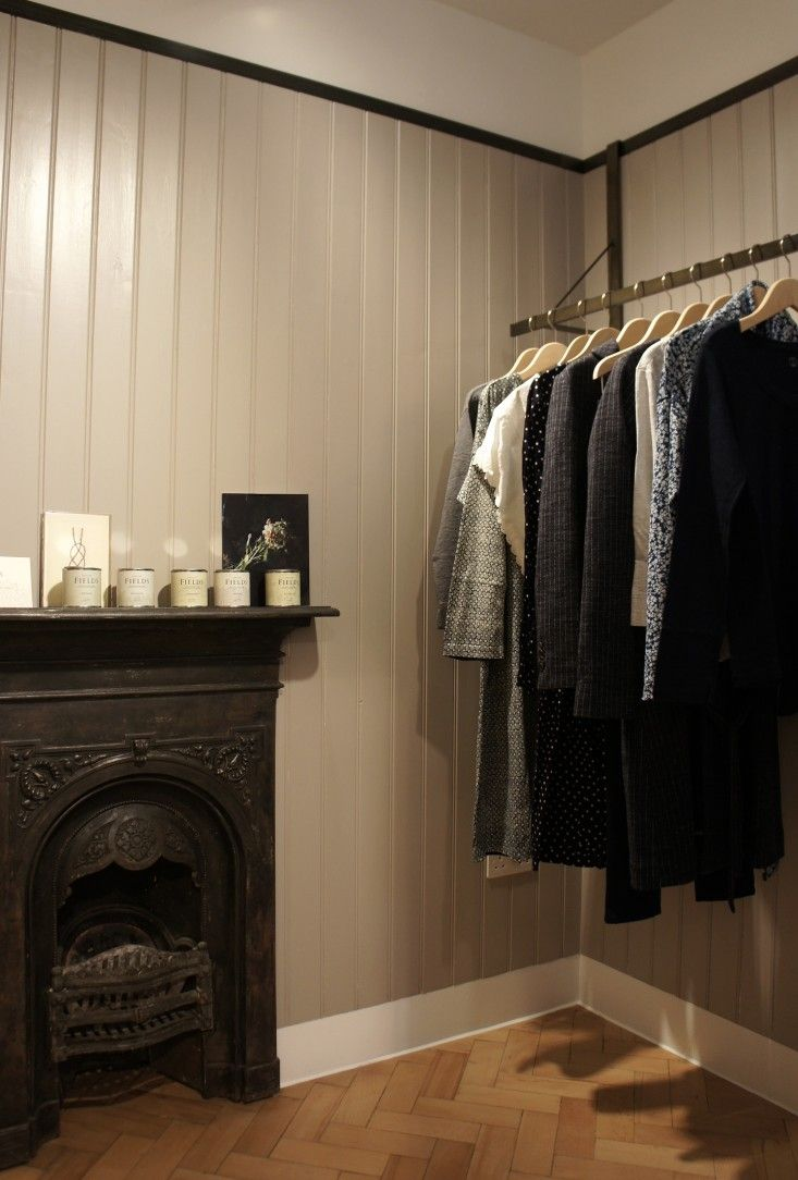 Mouki by William Russell, Pentagram, steel clothes rail, refurbished vintage fireplace mantel, gray painted ship lap, Land by Land candles,| Remodelista  wall details