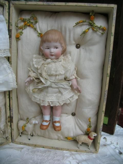 Heubach all bisque doll in presentation box, doll is 8 inches box if from dollcabinet on Ruby Lane