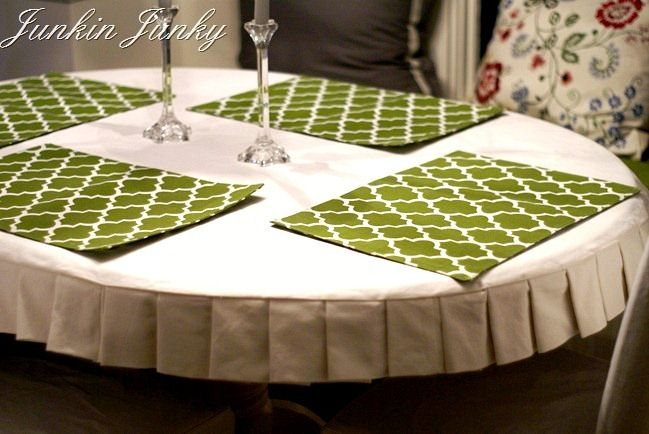 I like this, and that it's short and fitted. Maybe Meri can't pull it off the table as easily as a regular table cloth - ooo and make it out of laminated fabric too!