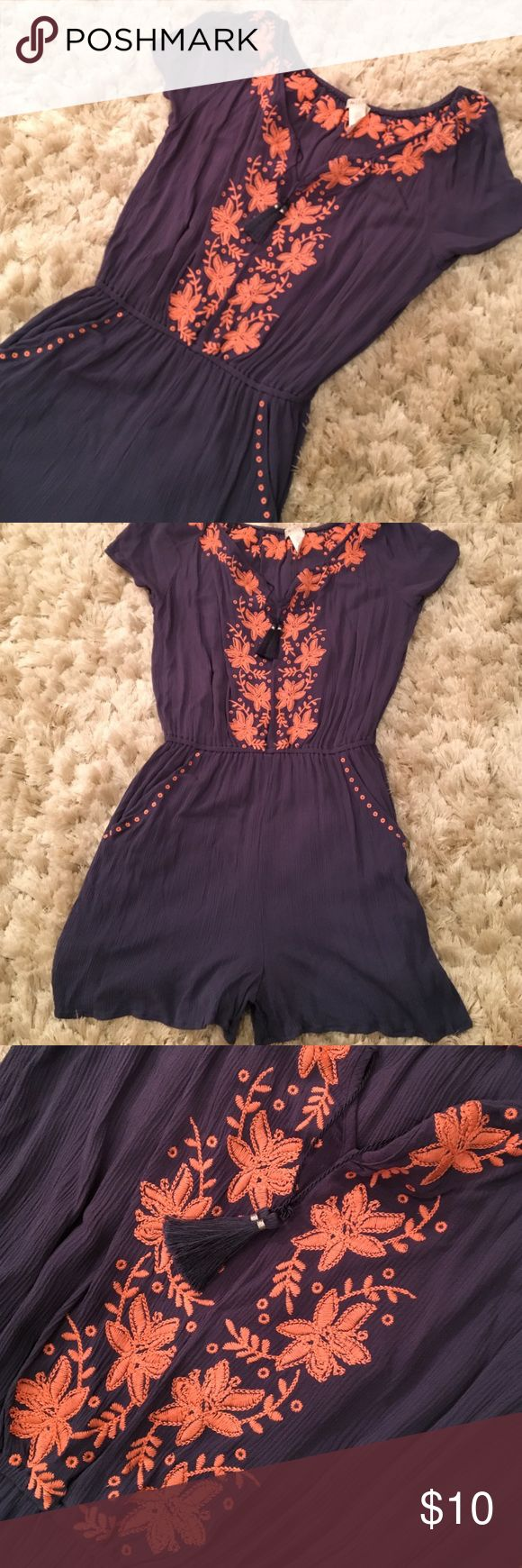 Navy Romper This super cute navy romper is perfect for those lazy summer days.  It has two pockets and some tassel ties.  The peach detail adds some cute flair.  No damage, except materials tag was cut off for comfort.  Neck, sleeves, and waist have elastic to stretch and fit perfectly.  Very comfortable. love, Fire Other