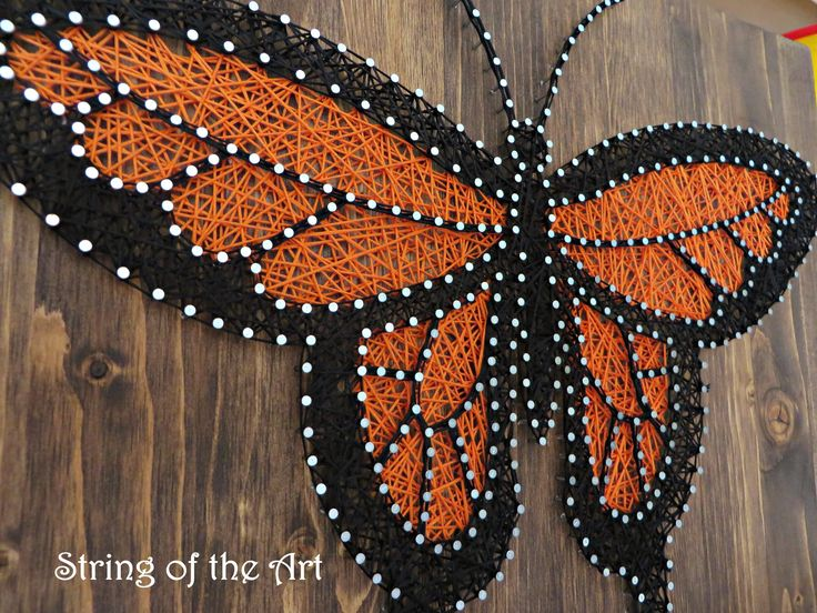DIY String Art Kit - Butterfly String Art, Monarch Butterfly String Art. This Beautiful monarch butterfly home decor DIY Kit comes with embroidery floss, hand sanded and stained wood board, wire nails, pattern template, and instructions. Visit www.StringoftheArt.com to learn more about this Monarch Butterfly DIY String Art Kit!