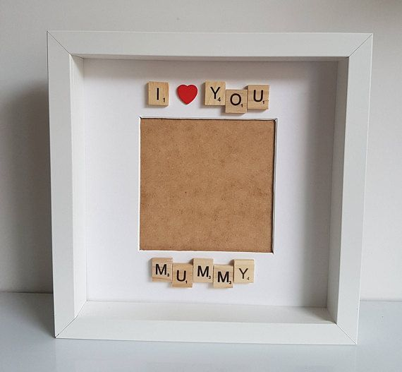 I love you mummy frame is a white 23cm x 23cm box frame with space for a 5x5 photo The I love you mummy scrabble Frame is a perfect first mothers Day gift or a gift for a mummy for a birthday or christmas. The box frame has I love mummy in wooden scramble letters above and