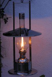 Sampan olilamp with flame