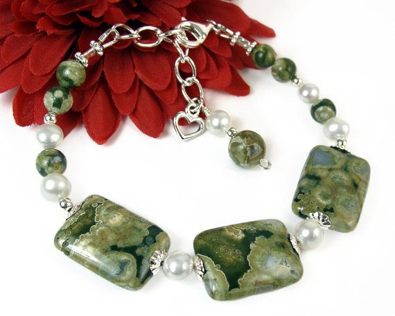 Styled in earthy elegance, this green gemstone adjustable bracelet features naturally unique rainforest jasper beads, glossy white freshwater pearls,