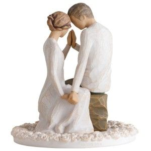 Around You Bride and Groom Wedding Cake Topper A gorgeous piece. The bride and groom are holding hands while kneeling.