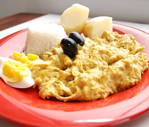 Aji de Gallina - Peruvian Creamy Yellow-Chili Chicken. A totally easy, totally delicious crowd pleasing dish. Can easily be prepared ahead of time, the flavors only get better! Use a rotisserie chicken & this becomes a perfect weeknight meal.