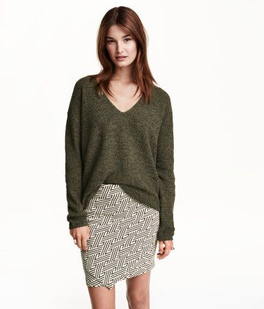 Khaki green, loose-fit V-neck sweater in a soft recycled cotton blend. Slightly longer at back. | Warm in H&M