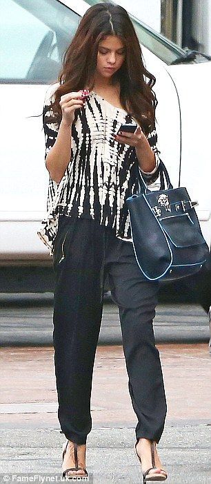 Fall #streetstyle | Selena Gomez in a tie die loose fit top, slouchy pants and t-strap heels