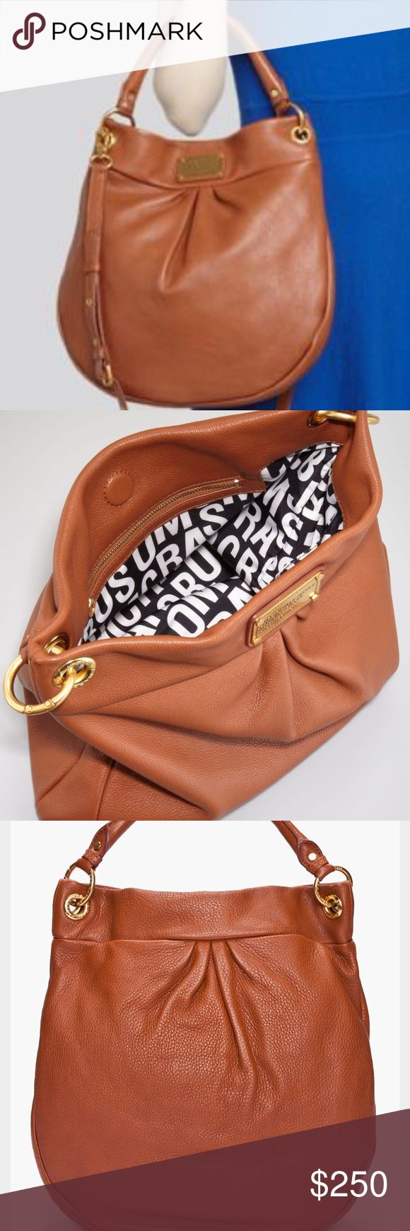"""Marc by Marc Jacobs Classic Q Hillier Hobo Bag Triple pleats. Soft, slouchy hobo. Maple tan. Rolled handle. (No shoulder strap). Like new condition on the outside. Some wear on grommets (pictured) and slight staining on inside. Magnetic snap closure. Interior zip, wall and cell phone pockets. Leather. 14""""W x 15""""H x 3 ½""""D. ***Jewelry and Accessories by Stella & Dot- See Bio.*** 👗Fab Ab's Closet; Re-styled Resale👗 🎀15% OFF 2+ ITEM BUNDLE🎀 😊PLEASE USE OFFER BUTTON ❌NO PP, TRADES, HOLDS❌…"""