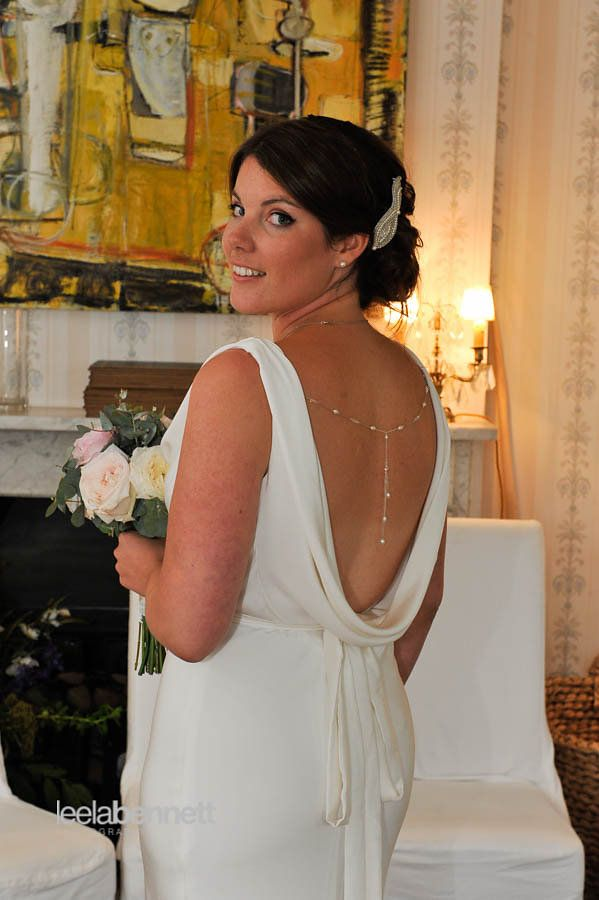 Laura wears Josephine, a bias cut, cowl neck, backless, slinky wedding dress. Photo by Leena Bennett. www.motasem.co.uk #cowlneckweddingdress #sabinamotasem