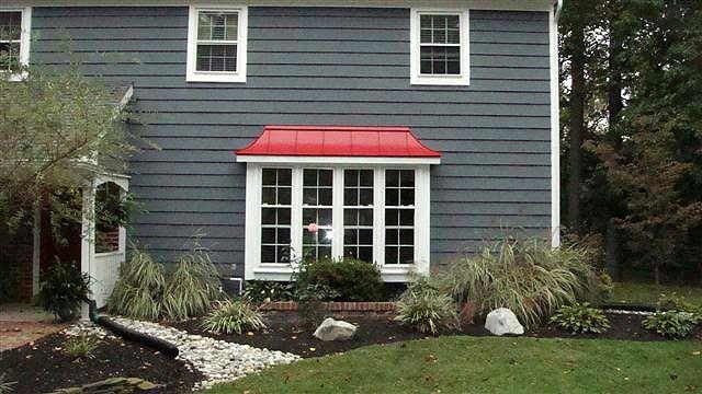Red Metal Roof & dark gray shingles