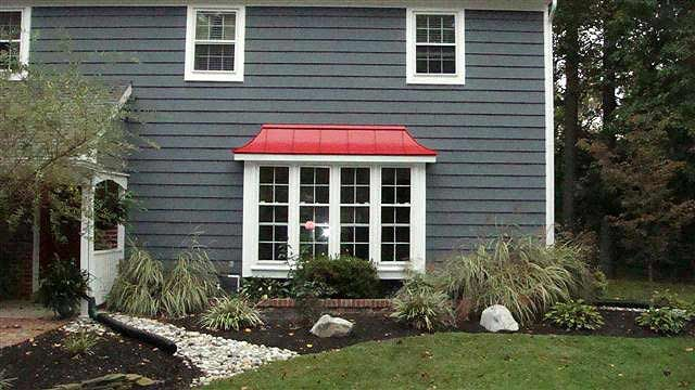 Red metal roof dark gray shingles house exterior for Red brick house with metal roof